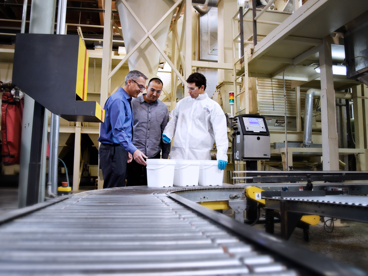 3 Precision Science employees performing product quality control in the factory